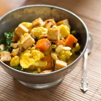 coconut curried sweet potato and cauliflower with sauteed kale, tofu and almonds